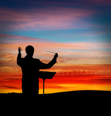 Conductor at sunset
