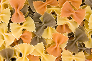 close up of uncooked multi-colored Italian macaroni