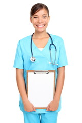 Young medical nurse / doctor holding clipboard