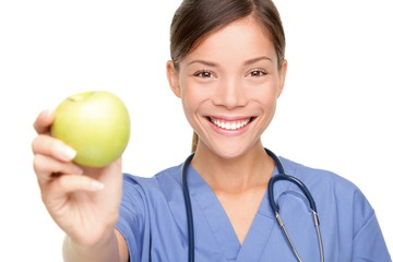 Nurse giving apple