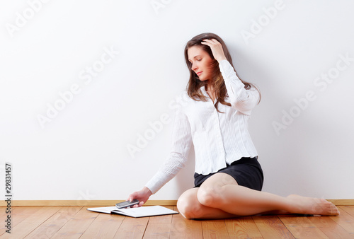 Young business woman writing sms