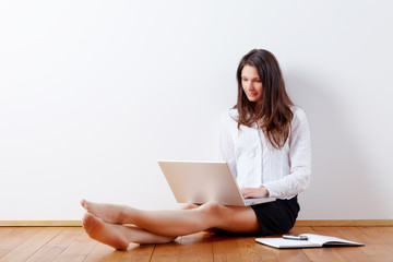 Young business woman working at home with laptop