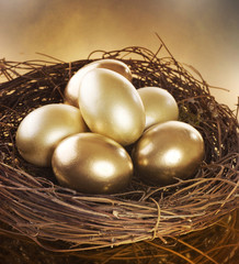 Easter. Golden Eggs in a Nest