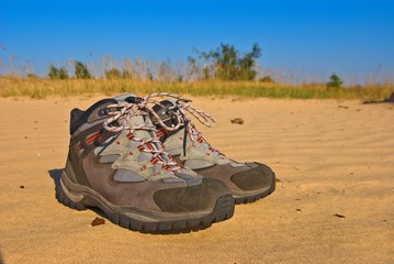 pair of touristic boots on a sand