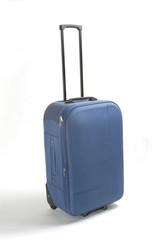 Maleta de viaje, azul con asa extendida