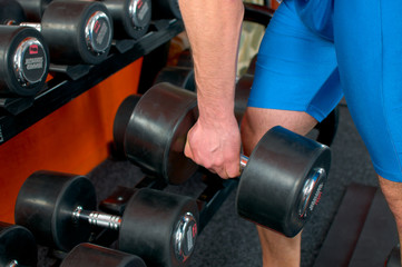Man arm lifting a dumbell