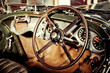 classic car steering wheel and dash abstract