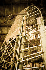 battered aircraft airframe and rudder abstract