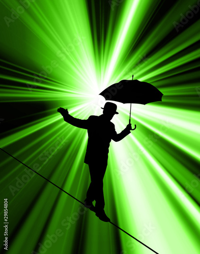 Silhouette of businessman on tightrope