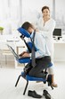 Masseur working in office