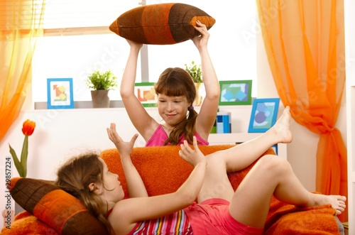 Girls playing pillow fight