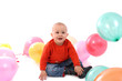 Playful boy with balloons