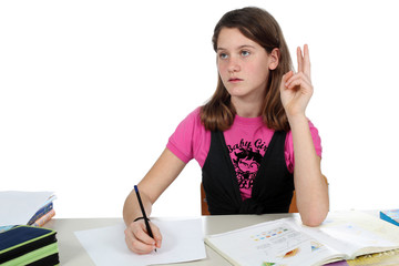 School girl is raising her hand to answer a question