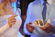 A bride and a groom are eating their wedding cake