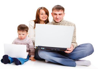 Parents  and toddler  with laptops