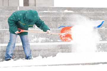 Man shoveling winter snow