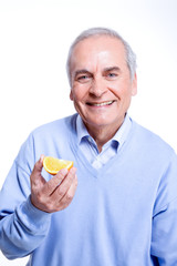 Man holding a piece of orange