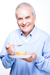 Old man eating fruits