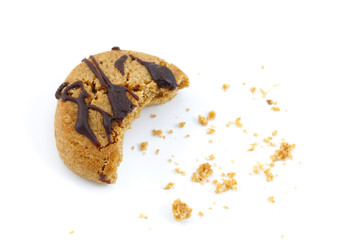 Chocolate covered cookie crumbs bite on white background