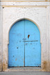Leinwanddruck Bild - Typical painted blue wooden door in Taroudant