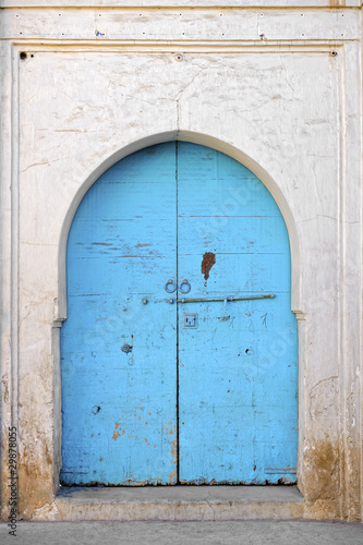 Leinwanddruck Bild Typical painted blue wooden door in Taroudant