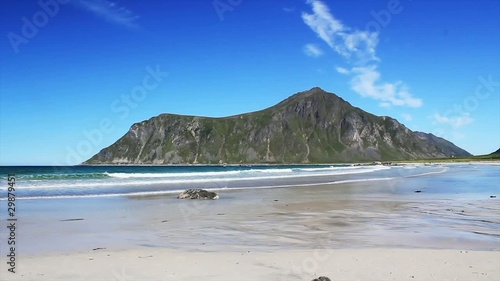isolated white beach with mountain on  the background