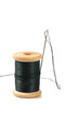 black thread spool with needle