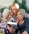 Mother and Teenage Daughter Reading Book Together
