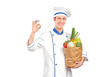 Chef gesturing delicious hand sign and holding a grocery bag