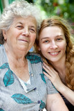 Family portrait of young woman and her grandmother
