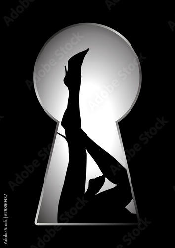 Silhouette of legs of a woman seen through a key hole