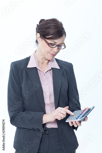 Businesswoman using pocket calculator