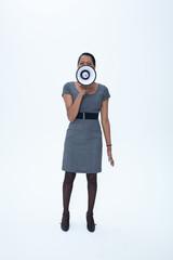 Businesswoman holding megaphone