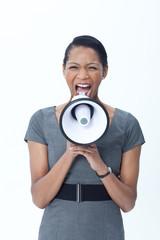 Businesswoman shouting into megaphone