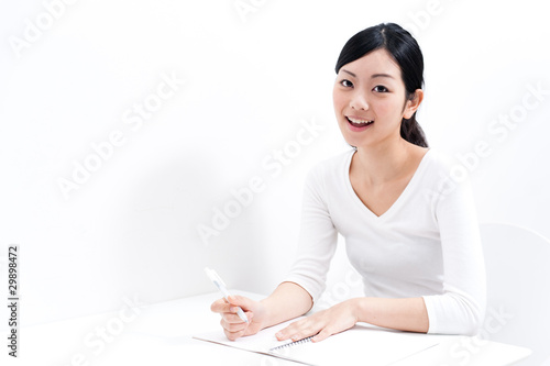 beautiful asian woman studying