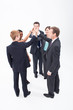 Five confident businesspeople high fiving