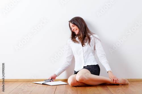 Young business woman reading sms and laughing