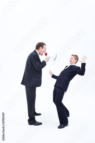 Manager shouting at businessman with megaphone