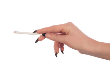 Female hand holds a cigarette