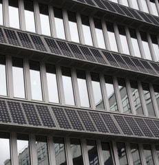 Solar Photovoltaic Panels Mounted On Building Facade