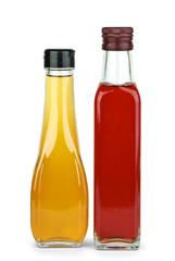 Two bottles with apple and red wine vinegar