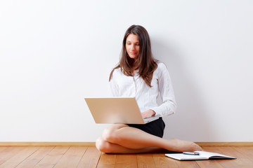 business woman at home with laptop