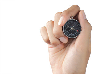 gesture of hand holding compass over white background