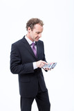Businessman using pocket calculator