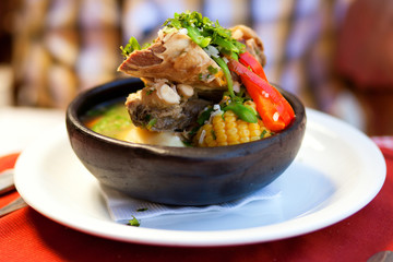 Chilean cazuela soup served in traditional clay plate