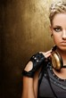 Portrait of an attractive steam punk girl with headphones