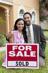 African American Couple & House For Sale Sold Sign