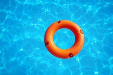 orange life buoy  on water