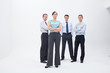 Serious female manager standing in front of businessmen