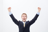 Enthusiastic businessman raising his arms